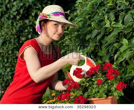 Young Gardener Woman Watering Plants
