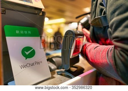 HONG KONG, CHINA - CIRCA JANUARY, 2019: close up shot of WeChat Pay payment services sign seen at Cafe De Coral in Hong Kong. WeChat Pay digital wallet service incorporated into WeChat.