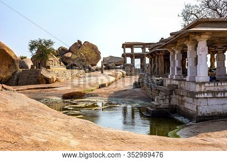 Beautiful View Of The Ruins With A Small Pond. The Group Of Monuments At Hampi Was The Centre Of The