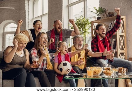 Excited, Happy Big Family Watching Football, Soccer Match On The Couch At Home. Fans Emotional Cheer