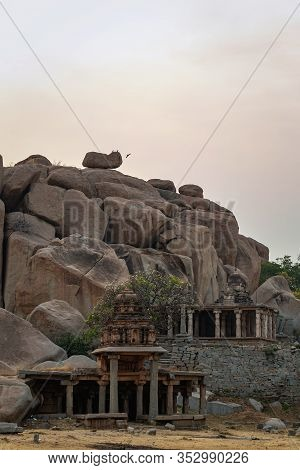 The Ruin Of Ancient Temples Near The Village Of Hampi. The Group Of Monuments At Hampi Was The Centr