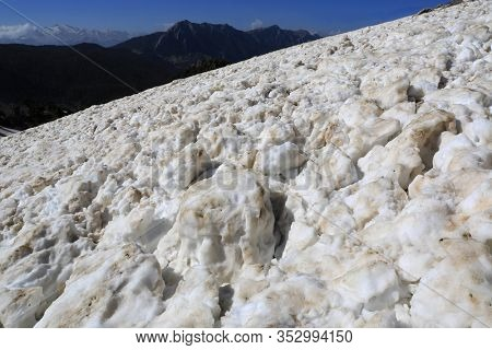 Landscape with snowy texture in the mountains after an avalanche