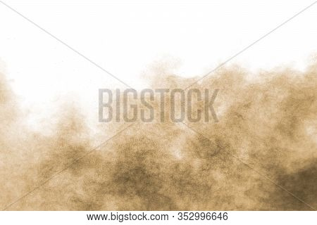 Abstract Deep Brown Dust Explosion On White Background.freeze Motion Of Brown Dust Splash.