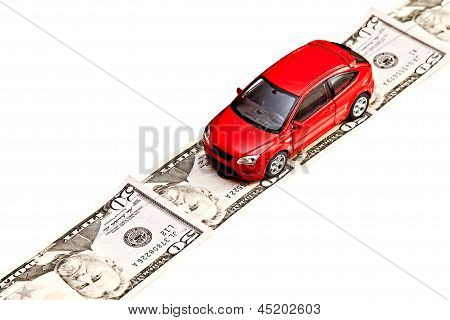Toy Car On The Money Road, Isolated On White