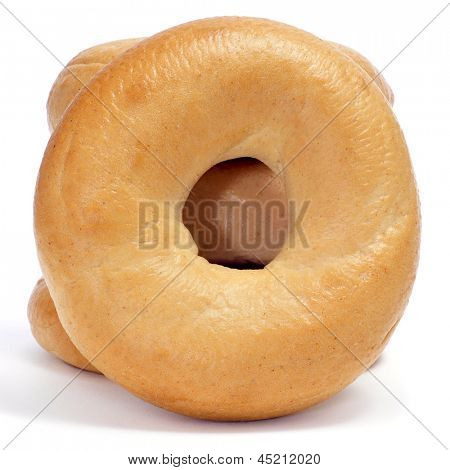 a pile of plain bagels on a white background