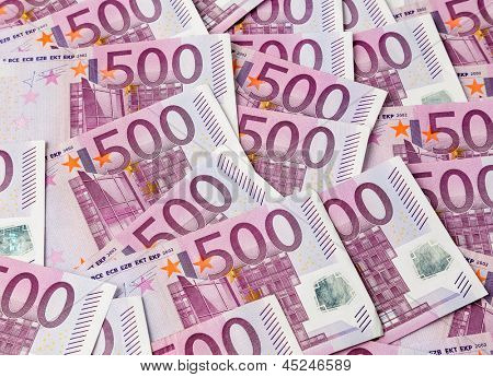 many of five hundred euro banknotes lie side by side. photo icon for wealth and investment