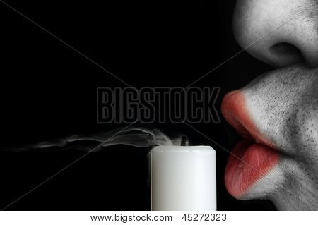 Unshaven Man Blowing Out Candle