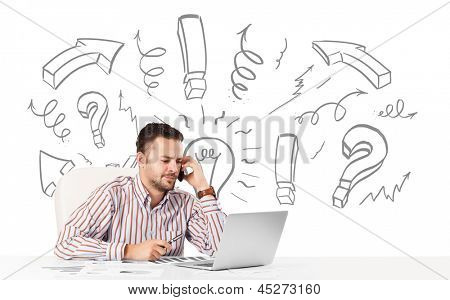 Good-looking young businessman brainstorming with drawn arrows and symbols poster