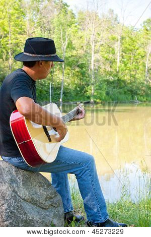 Guitar Player At The Pond