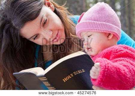 Mom And Baby Daughter Reading Bible