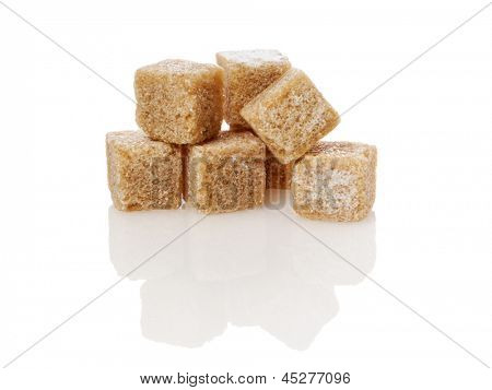 brown sugar cubes isolated on white background