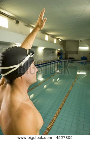 Swimmer With Hand In Air - Vertical