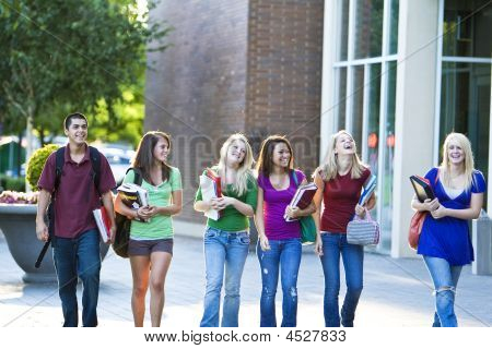 Students Carrying Books - Horizontal