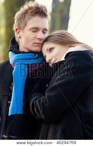 portrait of young caucasian couple standing together enjoying themselves poster