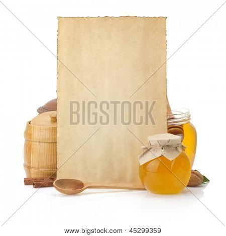 cooking recipes background and jar full of honey on white