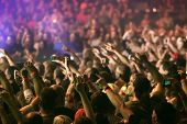 Crowd at a music concert, audience raising hands up poster