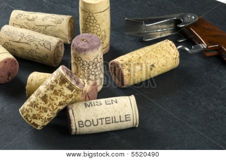 Wine corks and opener on a slate background mis en bouteille printed. poster