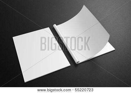 Blank Magazine On The Dark Background
