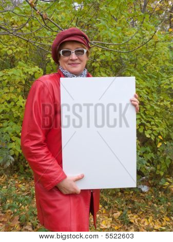 Lady In Red Holds An Empty Poster.