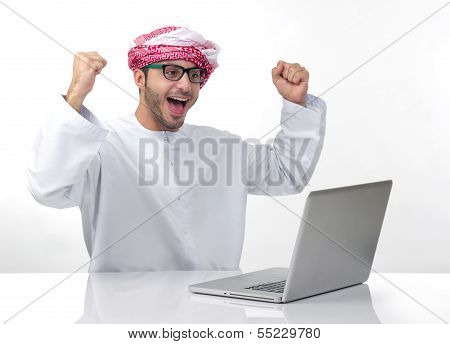 Arabian excited businessman expressing success