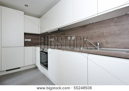 Contemporary Kitchen With Natural Stone Worktop And Tiles In White