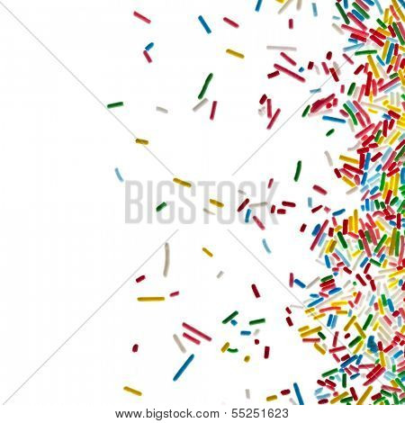Border frame of colorful mini sweet sprinkles making sprinkles isolated on white background card for text