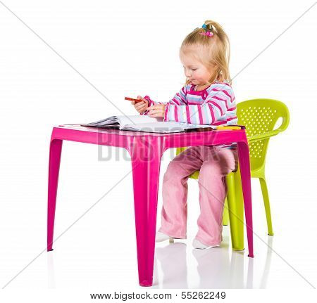 Child Drawing With Crayons Isolated On White