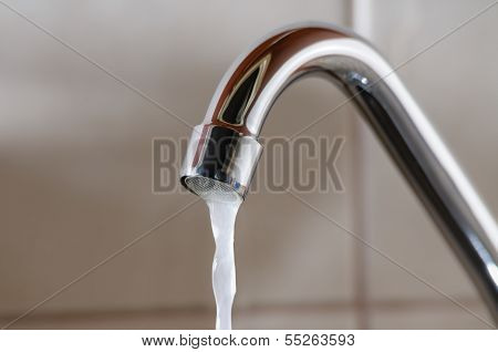 Tap With Water Flowing Slowly