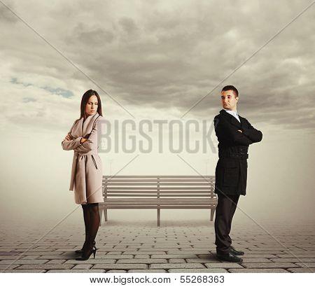 sorrowful couple in quarrel