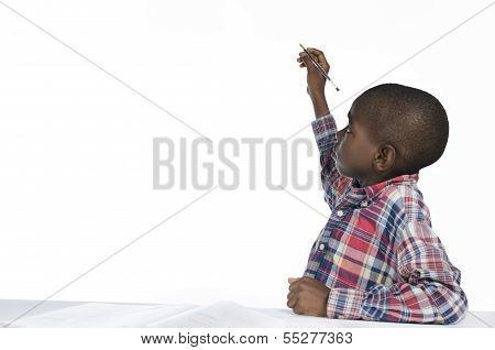 African Boy Writing With Pencil, Free Copy Space
