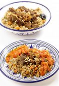 A traditional Saudi Arabian or Gulf Arab meat kabsa meal, of rice, onion, carrots, capsicum, spices, and beef, served with a homemade tomato sauce topping. This  is also known as majbus or machboos poster