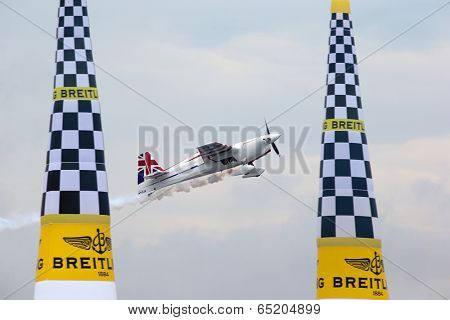 PUTRAJAYA, MALAYSIA - MAY 17, 2014: Paul Bonhomme of Great Britain, in an Edge 540 V2 plane flies past the pylons duirng the qualifying session of the Red Bull Air Race World Championship 2014.