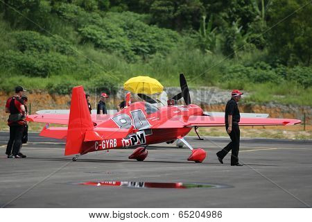 PUTRAJAYA, MALAYSIA - MAY 16, 2014: Pilot Pete McLeod of Canada, piloting an Edge 540 v3 plane readies to take off for a practice flight at the Red Bull Air Race World Championship Putrajaya 2014.