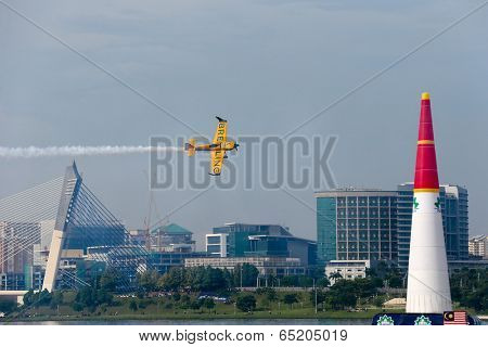PUTRAJAYA, MALAYSIA - MAY 17, 2014: Nigel Lamb from Great Britain flies his MXS-R plane through the race course at the qualifying session of the Red Bull Air Race World Championship 2014 in Putrajaya.