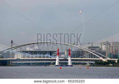 PUTRAJAYA, MALAYSIA - MAY 17, 2014: Paul Bonhomme from Great Britain in an Edge 540 V2 plane makes a vertical climb during the qualifying session of the Red Bull Air Race World Championship 2014.