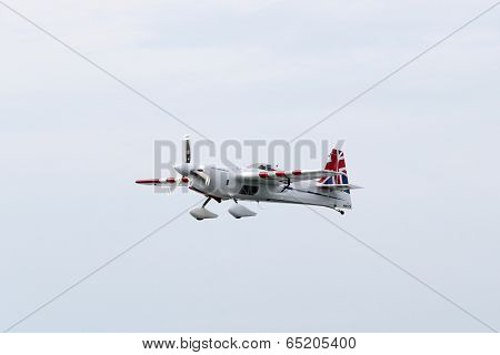 PUTRAJAYA, MALAYSIA - MAY 17, 2014: Paul Bonhomme from Great Britain in an Edge 540 V2 plane takes to the skies over Putrajaya lake during the Red Bull Air Race World Championship 2014.