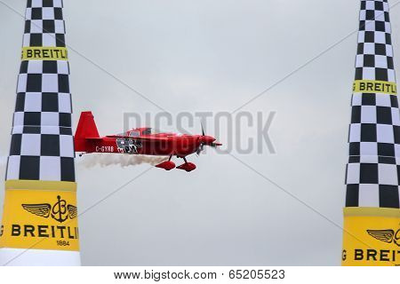 PUTRAJAYA, MALAYSIA - MAY 17, 2014: Pete McLeod of Canada, in an Edge 540 V3 plane flies past the pylons at the qualifying session of the Red Bull Air Race World Championship 2014.