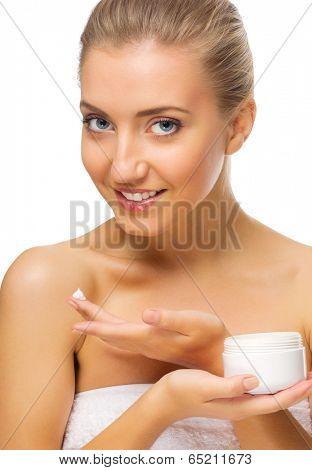 Young helathy girl with body cream jar isolated
