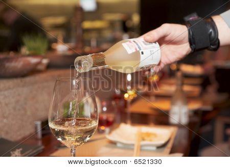 Waiter Pouring Saki
