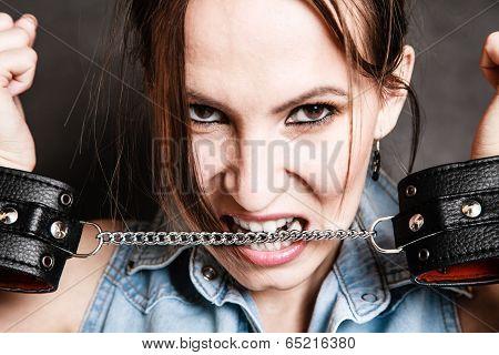 Arrest. Criminal Woman Prisoner Biting Handcuffs