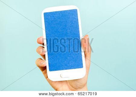 Blue Screen Vertical Mobile Concept On Blue Background. Hand holding a smartphone