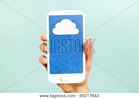 Mobile cloud computing on blue background on a cell phone. Internet concept. Hand showing.