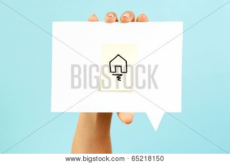 Hand holding a Homepage Symbol On Speech Bubble With Blue Background