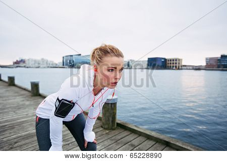 Young Woman Resting After Run