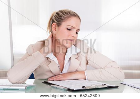 Businesswoman Suffering From Neck Pain