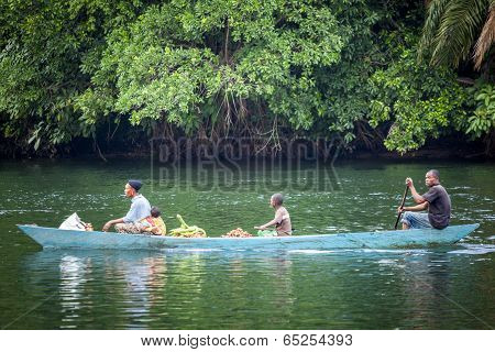 Family Using Traditional Way Of Transportation In Ghana, Africa