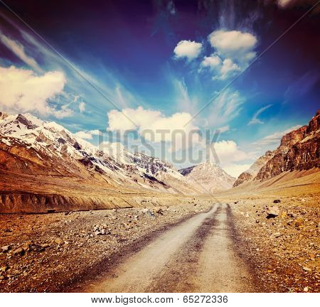 Vintage retro effect filtered hipster style travel image of Road in mountains (Himalayas). Spiti Valley,  Himachal Pradesh, India