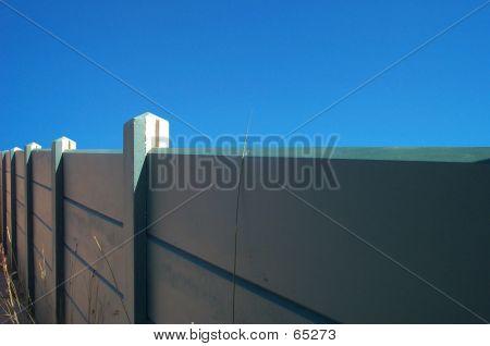 Green Wall On Blue Sky