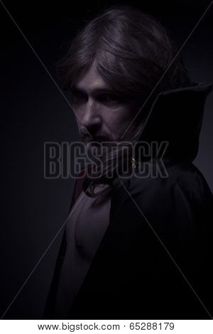 Mysterious man with long hair and black coat