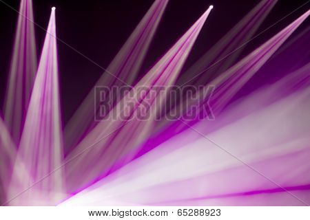 Defocused entertainment concert lighting on stage bokeh. poster